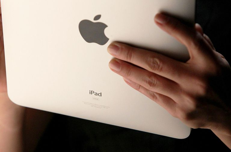An event guest plays with the new Apple iPad during an Apple Special Event at Yerba Buena Center for the Arts January 27, 2010 in San Francisco, California.