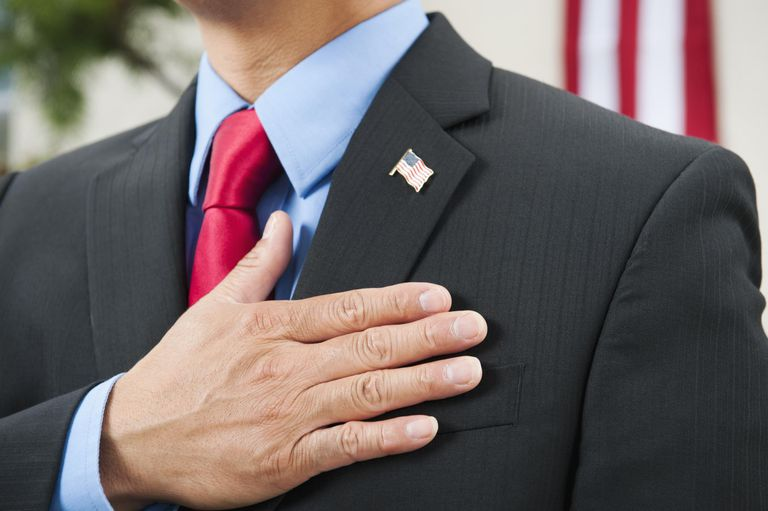Pledging allegiance to American flag