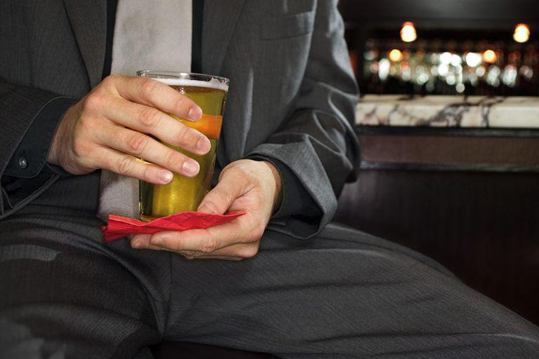 Hands of man holding beer