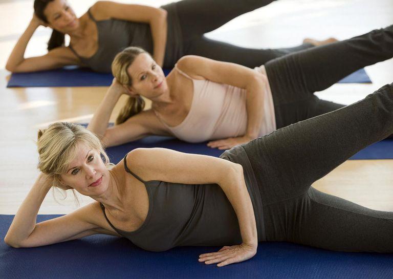 Multi-ethnic women practicing yoga