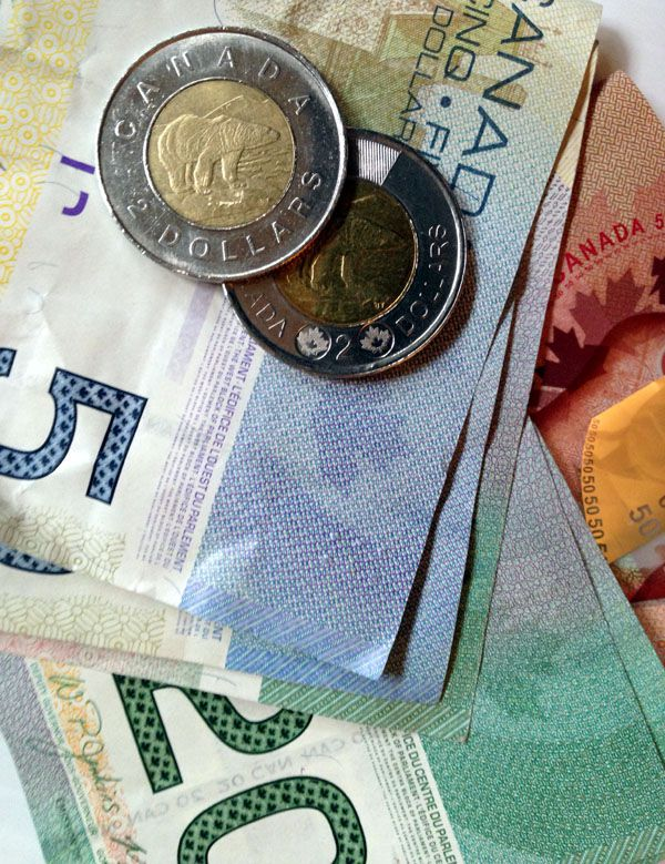 Colorful Canadian dollar bills and the two-tone $2 coin