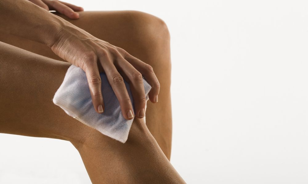 Woman with ice pack on knee