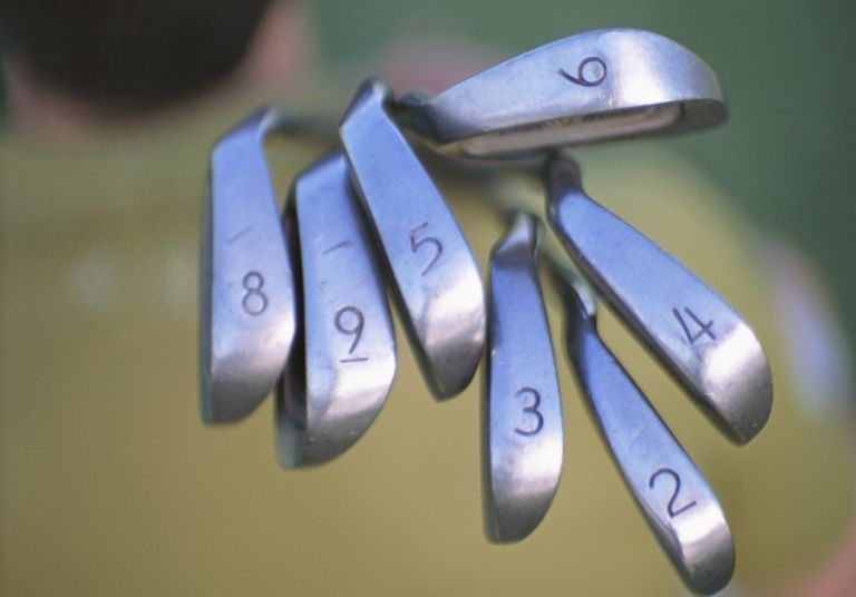 Various types of golf irons carred by golfer