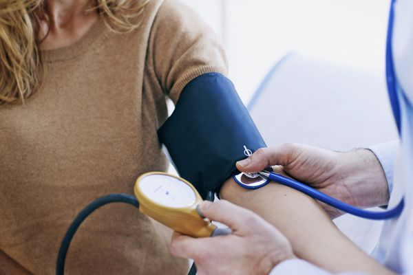 Doctor measuring patients Blood Pressure