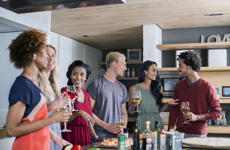 Group of friends talking and drinking wine