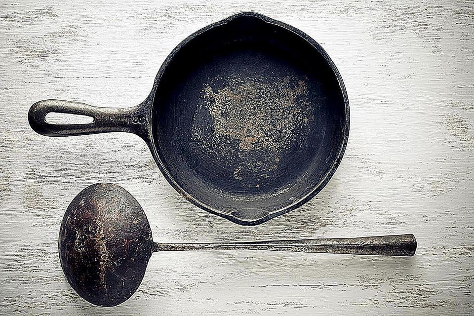 Vintage iron cast skillet and scoop.