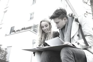 'University students working with folder and digital tablet, Munich, Bavaria, Germany'
