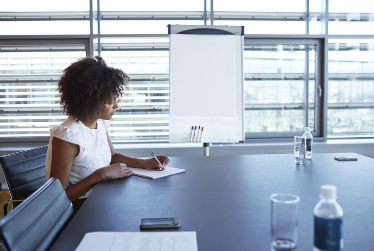 Businesswoman taking notes in conference room