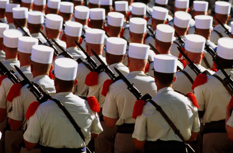 White cap (kepi blanc) soldiers of Foreign Legion marching in Bastille Day parade