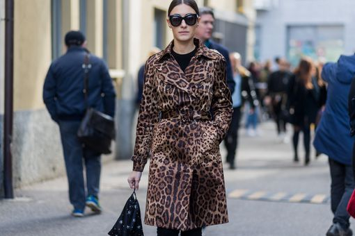 Woman in leopard print coat and sunglasses