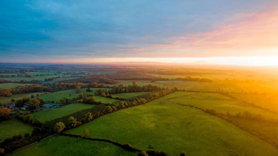 Colorfull sunrise on foggy day over Tipperary mountains and fields.Ireland