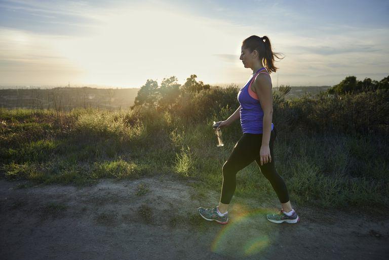 Woman walking a trail