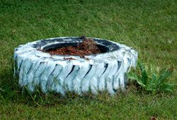 Picture of old, painted tire used in landscaping: example of bad landscaping.