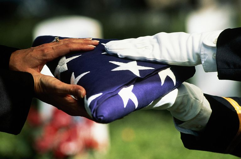 U.S. military funeral with American flag