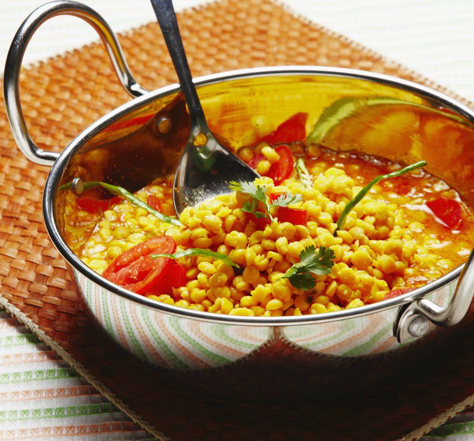 Spoon in bowl of curry with chickpeas