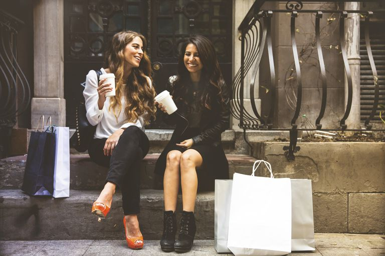 Two women with shopping bags and coffee