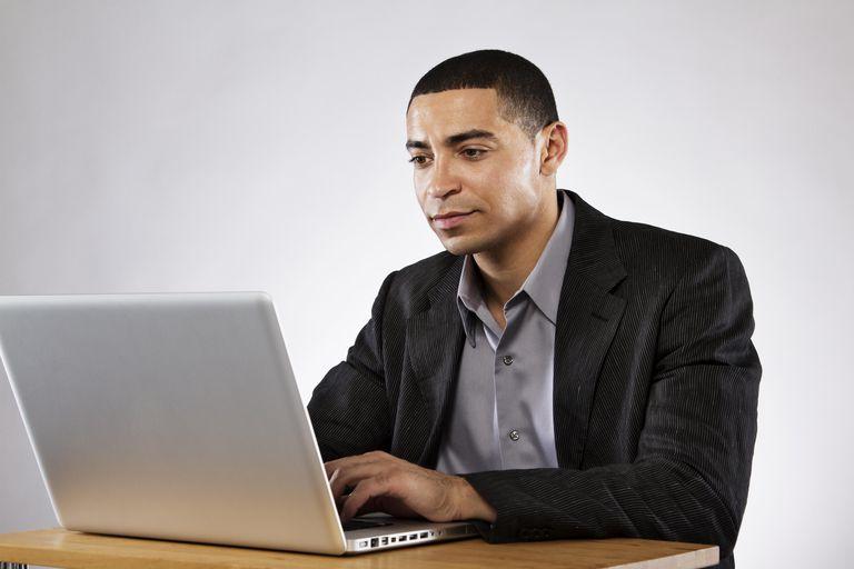 Businessman On Computer At Desk