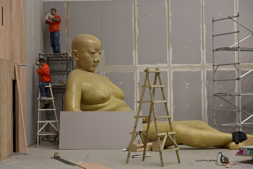 Workers prepare for the next exhibition at the Power Station of Art in Shanghai.