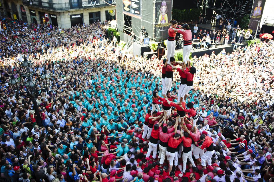 Castellers (Human Castles) at the St. Jaume Square for the last day of 'La Merce' Festival in Barcelona, Catalonia, Spain 2011.
