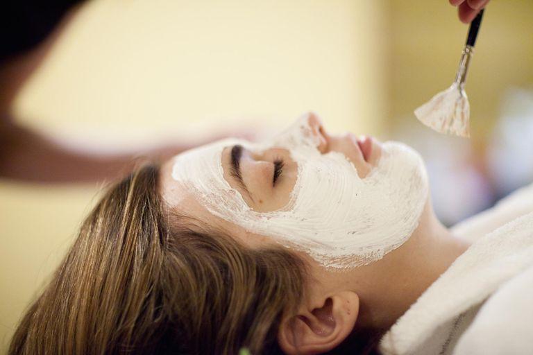 A woman getting an acne facial