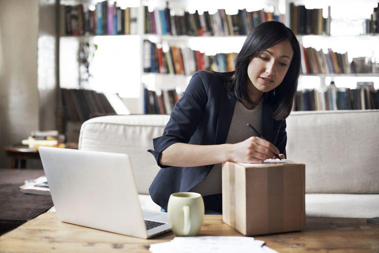 Woman preparing parcel for shipment