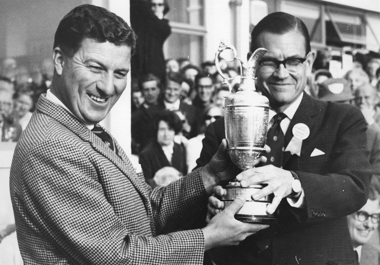 Australian golfer Peter Thomson receiving the trophy after winning the British Open in 1965