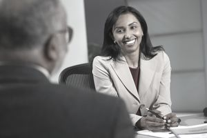 Businesswoman talking to man