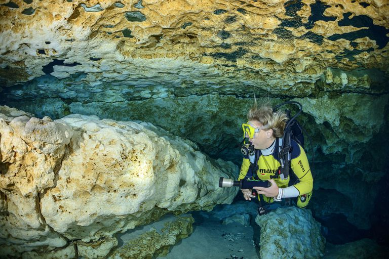 Scuba diver at Ginnie Spring Cave, Florida, USA