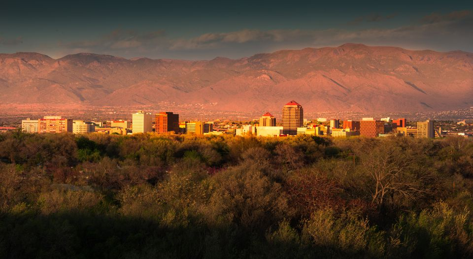Albuquerque skyline at sunset, downtown buildings, Sandia Peak in background