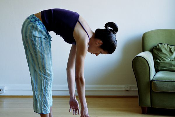 Bending over into hip and spinal flexion