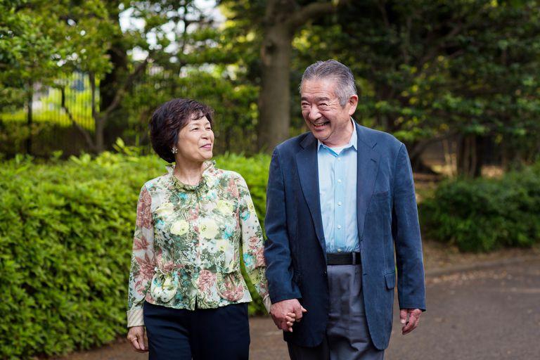 Senior couple walking while holding hands