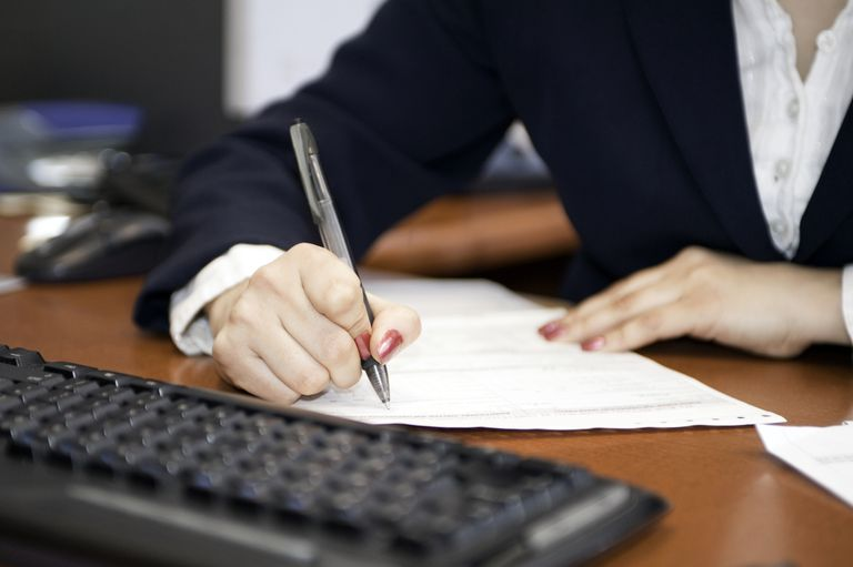 Businesswoman filling out paperwork