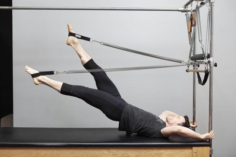 Man doing Pilates on Machine