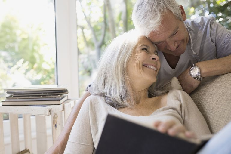 Senior couple hugging in living room
