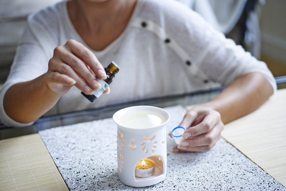 Woman using essential oil diffuser