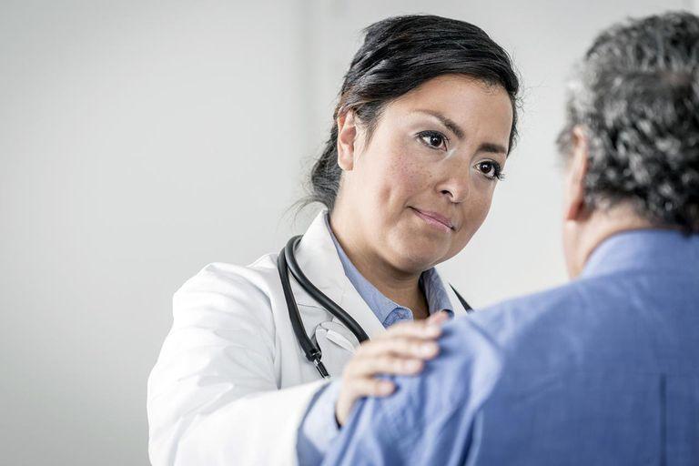 Doctor comforting senior patient
