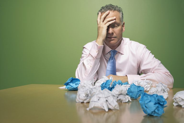 Businessman with crumpled papers