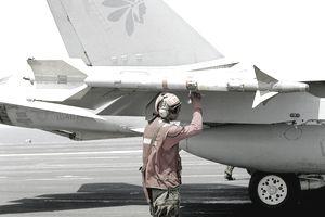 Navy aviation ordnanceman prepares to arm