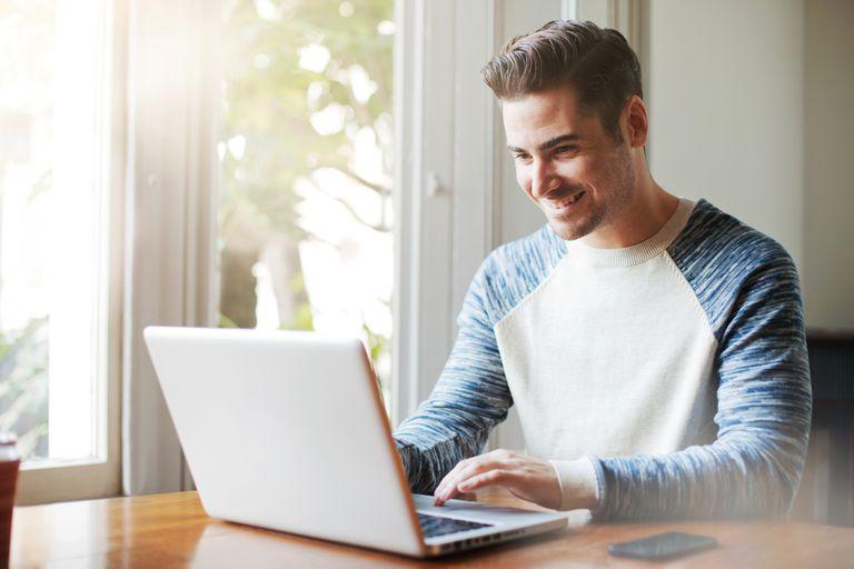 write-laptop-smile-Tim-Robberts.jpg