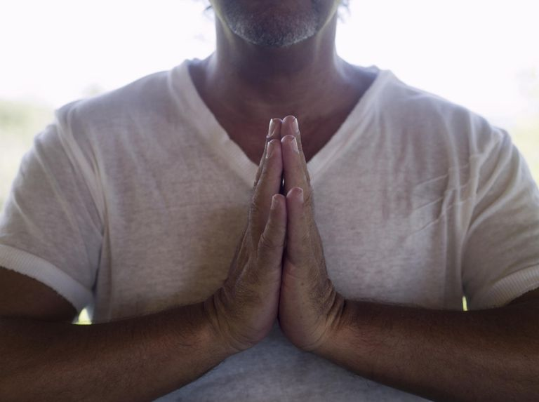 Mature man with hands clasped, mid section, close up