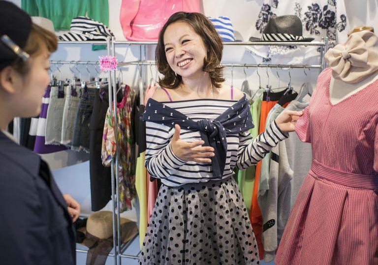 Female salesperson serving customer