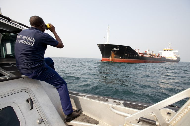 Anti-piracy team checking on a ship off the coast of Benin, West Africa