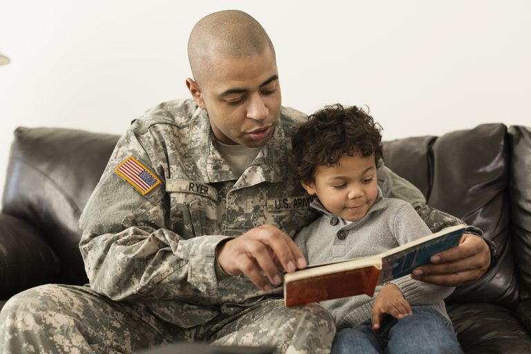 military parent reading book with child