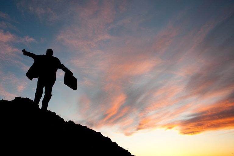 These quotes will help you accomplish all of your goals and dreams. A man celebrates on top of a mountain