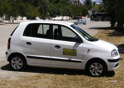 A rental car in Greece, in a nice neutral color for a change.
