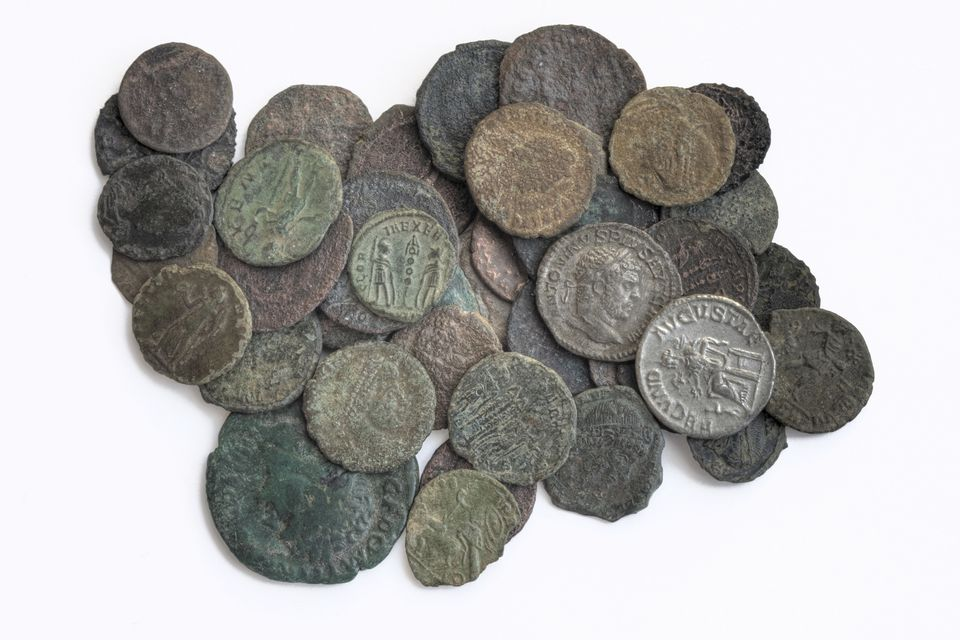 a pile of ancient coins