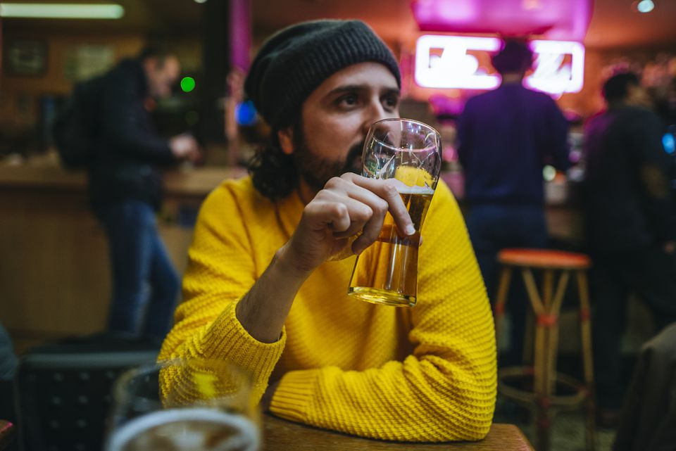 Man with glass of beer in a pub