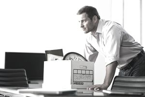 Man packing box on desk