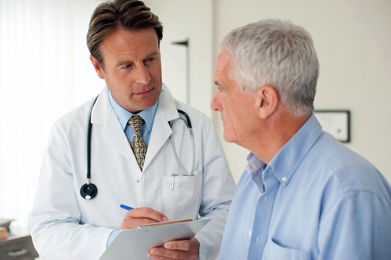 Doctor talking with patient in doctor's office