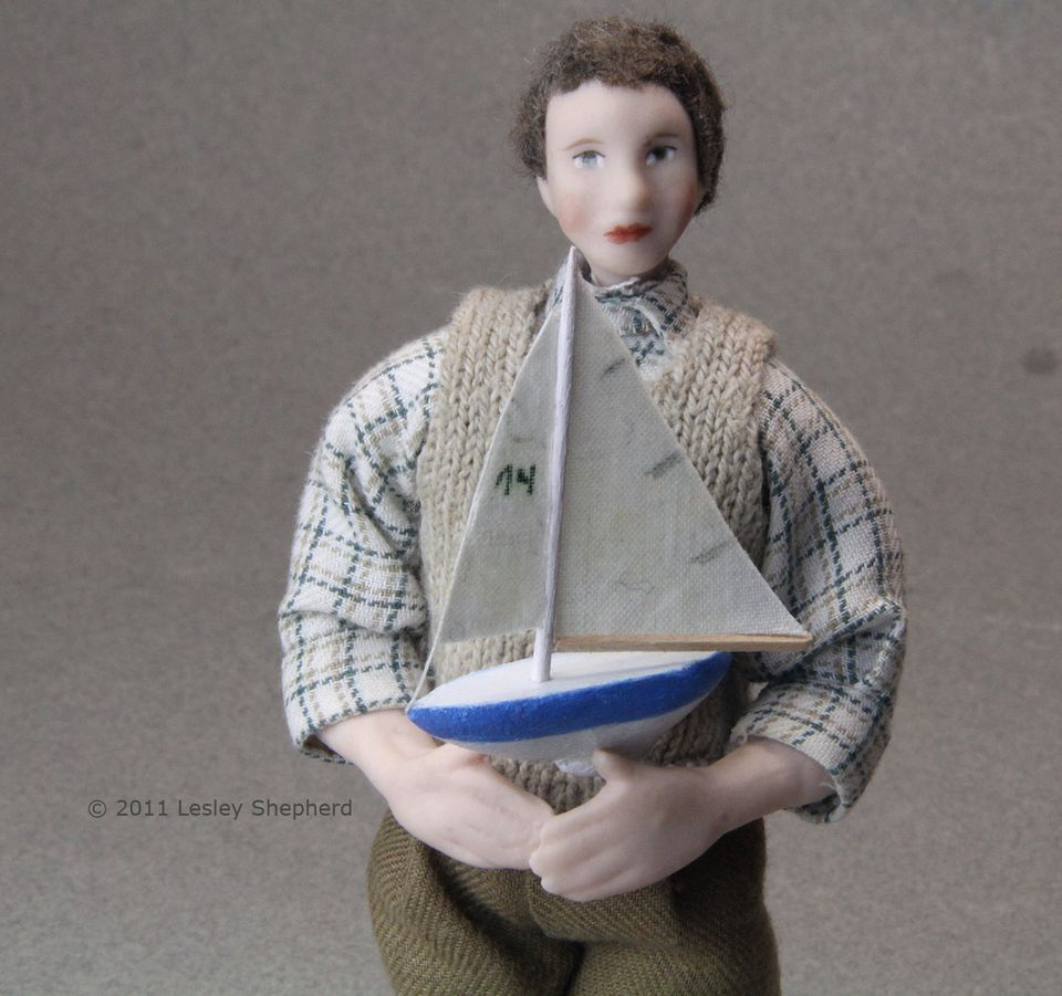 Toy sailboat in dollhouse scale carved from scrap craft wood
